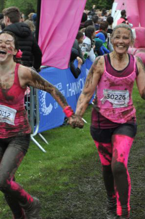 Crossing the finishing line in the mud
