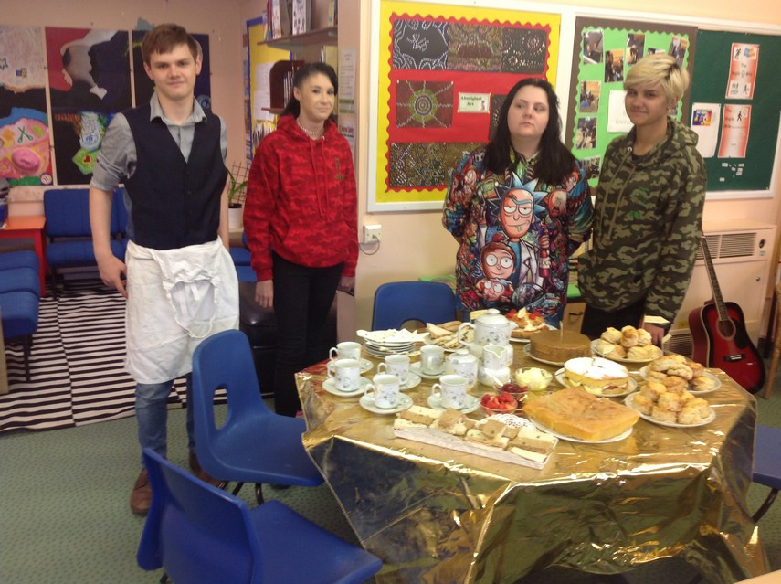 Pupils with afternoon tea laid out on table